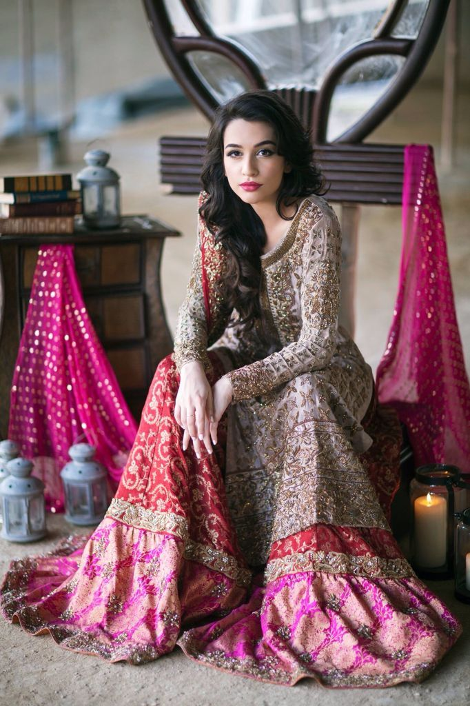 How magnificent does this bride look adorning an embellished sharara in traditional hues.