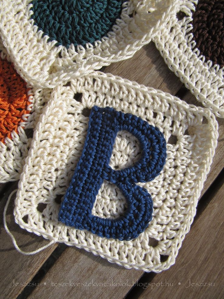 Applique letters for crochet - page is in Hungarian, but with links to pattern in crochet symbols! Love it!