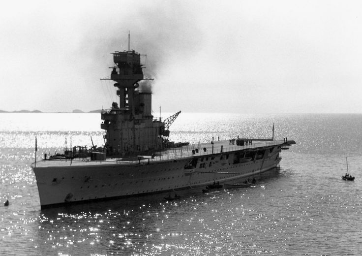"""The British carrier HMS Hermes (95) pictured underway off Yantai (known in the West as """"Chefoo"""" then), China."""