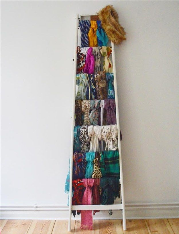 Stop stepping on your ladder and use it as a scarf storage device instead. | 31 Incredibly Creative Ways To Display All Your Stuff