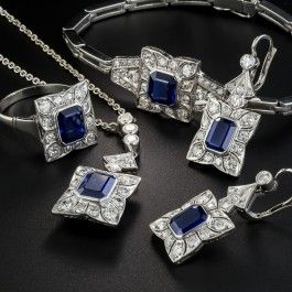 Complete suites of vintage jewels are few and far between, and this late-Art Deco sapphire and diamond ensemble, comprised of a ring, earrings, bracelet and necklace is absolutely stunning. Hand fabricated in the 1940s in palladium, a look-a-like cousin of platinum, which was required as a strategic metal during the WWII years (thus a more peaceful precious metal), each piece features a vibrant royal blue emerald-cut sapphire, all five of which total 8.75 carats.