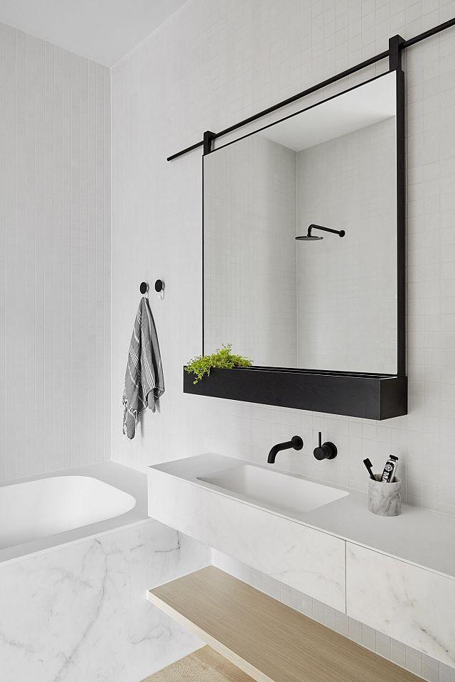 Statuario Matte. Maple Apartments. Melbourne, VIC / sliding mirror  White marble bathroom with black accents