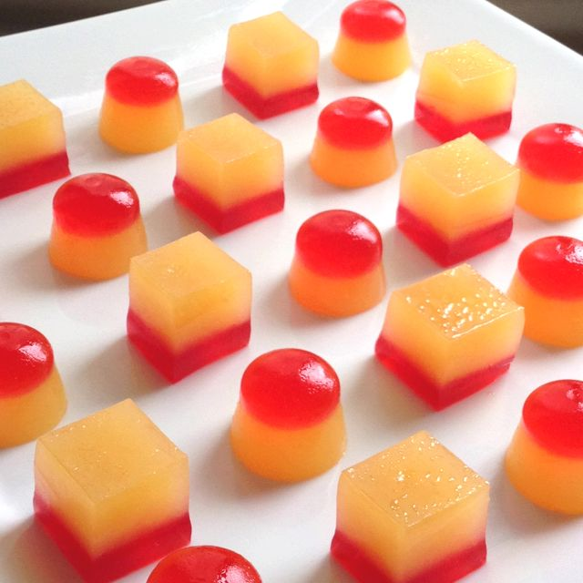 Tequila sunrise jello shots! Mix grenadine layer ingredients (3/4 cup grenadine, 1/4 cup water, 1 envelope gelatin) over low heat layer and pour into pan sprayed with cooking spray. Cool until set in fridge. Mix sunrise layer ingredients (1.5 cups orange juice, 3 envelopes gelatin, 1.5 cups gold tequila) and pour over top of grenadine layer. Cool both layers in fridge to set. Use knife to cut into squares, pop out and serve!
