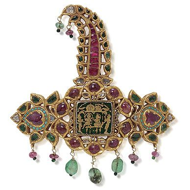 A GEMSTONE SARPECH - A turban ornament designed as a tapering openwork panel, two sides centering on a kundan set pear-shaped ruby cabochon, with a surround of similarly set turquoise cabochons, emerald cabochons & table-cut 'polki' diamonds, to a central thewa work plaque, with a surround of table-cut 'polki' diamonds & ruby cabochons, suspending a fringe of emerald & ruby beads, to the tapered aigrette or 'kalgi' of similar design, suspending a ruby & an emerald bead, mounted in 22 K gold