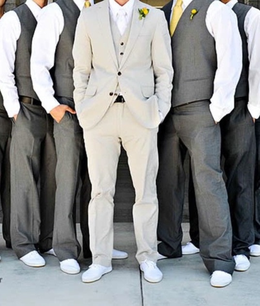 light grey tuxedos for the groomsmen and dark grey for my groom with white shoes.