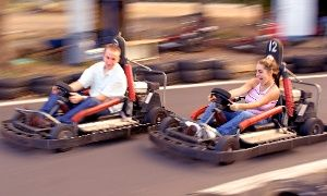 Groupon - Go Kart Races and Mini-Golf for 5, or Go-Kart Races for 2 at Cooter's Place (Up to 51% Off). 3 Options Available. in Gatlinburg. Groupon deal price: $27