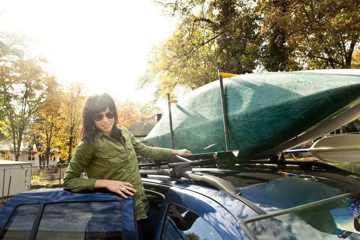 Most car roof racks can easily carry two kayaks if the proper procedures are followed when securing them.