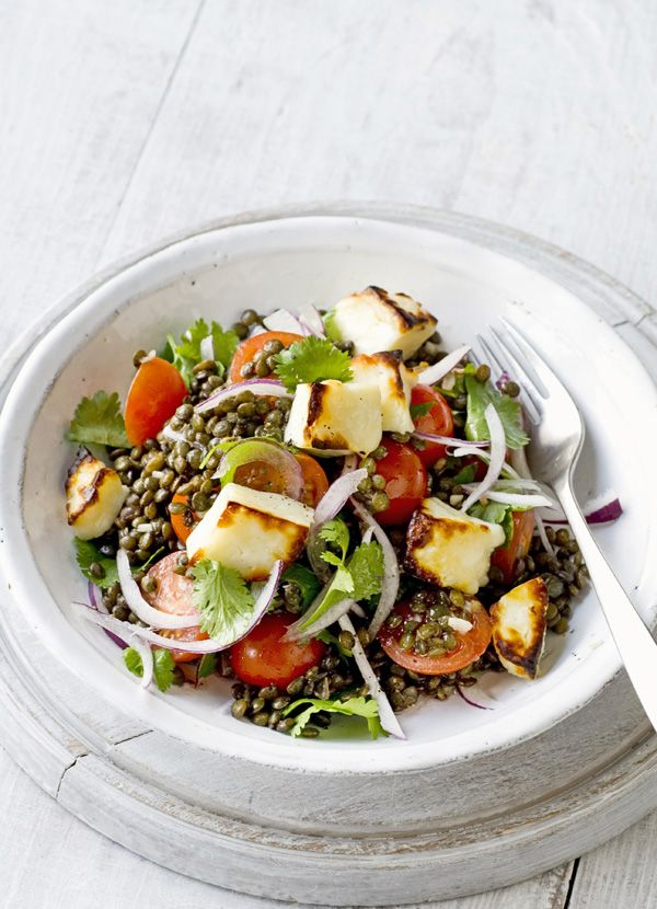 Warm Puy lentil, cherry tomato and halloumi salad a hearty, nutritious, salad that can satisfy a healthy appetite and be assembled very quickly. Tender Puy lentils and squeaky, golden, halloumi are served with a salad of tomatoes, red onion and lemon juice.
