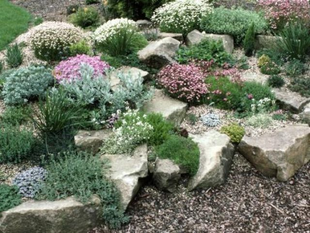 large rocks with greenery and flowers