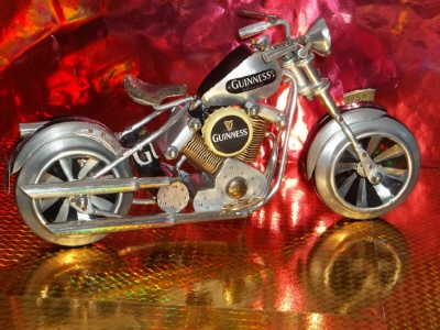 This motorcycle was made out of cans and a bottle cap. It looks almost like the real deal!