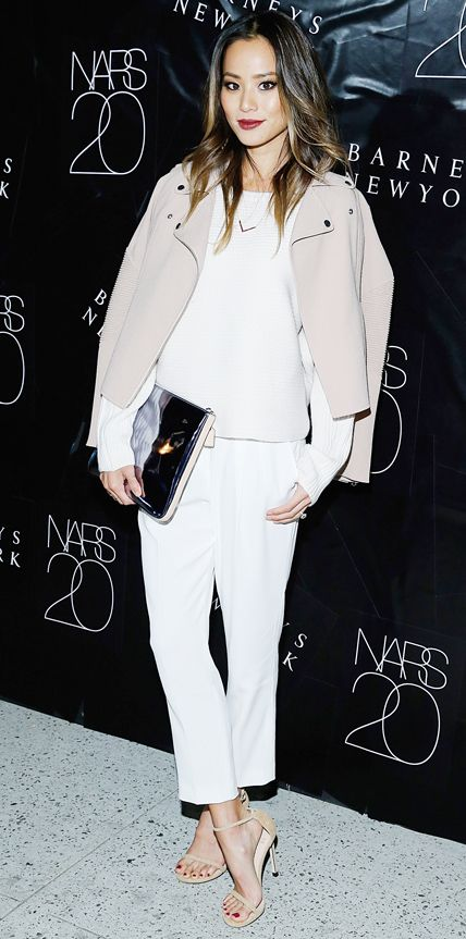 Jamie Chung took a sophisticated sartorial approach for the NARS 20th Anniversary Celebration at Barneys New York in head-to-toe Aritzia, from her white knit to her tailored trousers to her taupe moto-style jacket (draped casually over her shoulders). She accessorized with a mirrored clutch and delicate ankle-strap sandals.