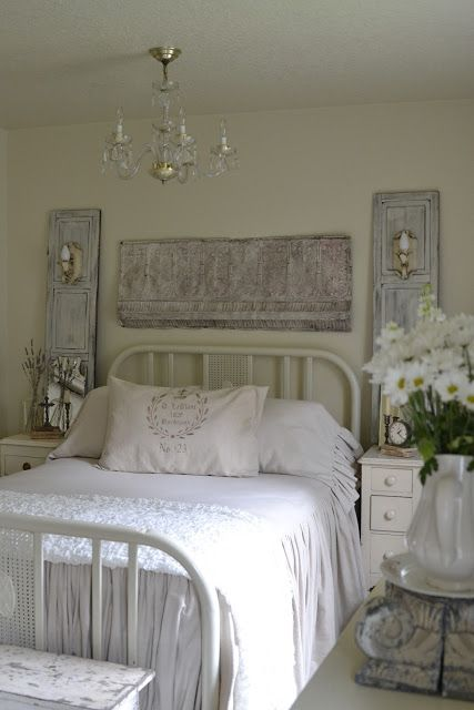 Shutters are standing behind side tables. Each has an attached  sconce for lighting. Wall does not have to be damaged. Love the neutral white pallet. Faded Charm: ~Sweet Dreams~