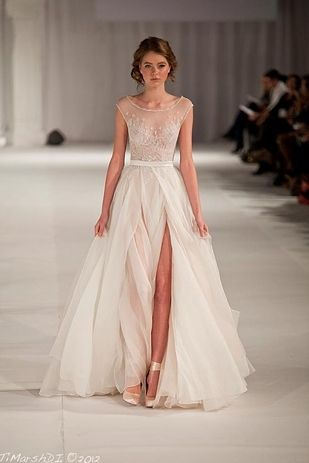 The way a dress can be long and elegant while showing a LOT of leg. | 50 Gorgeous Wedding Dress Details That Are Utterly To Die For