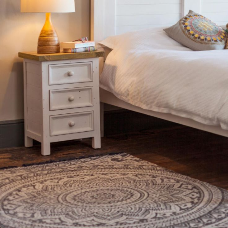 Hand blocked printed flat-woven cotton rug carries a mandala design – decorative circular patterns representing the universe in Hindu & Buddhist symbolism.  Made in Indian.