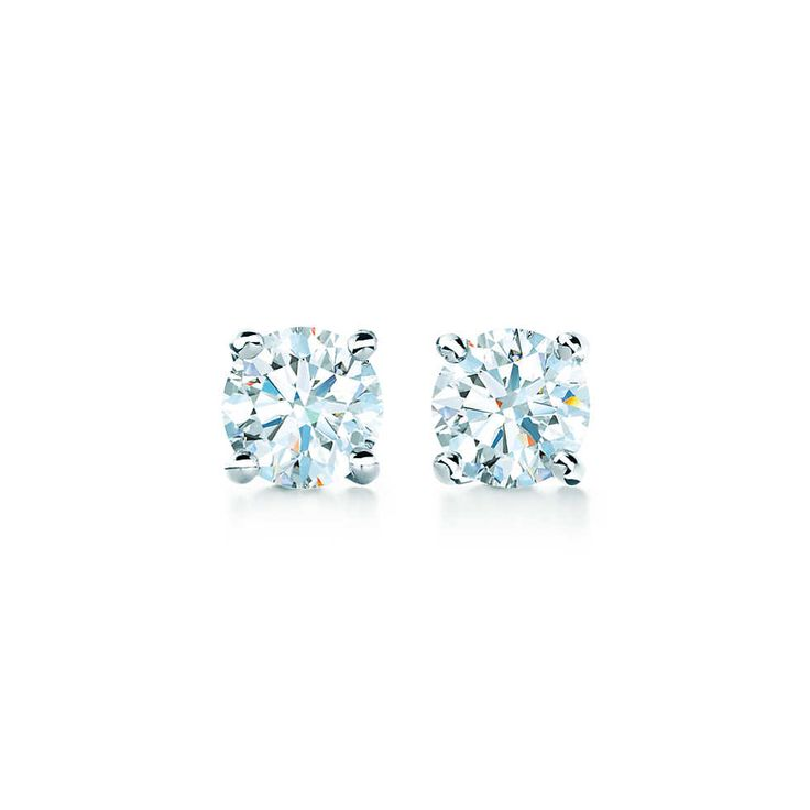 Tiffany solitaire diamond earrings in platinum.   Tiffany & Co.