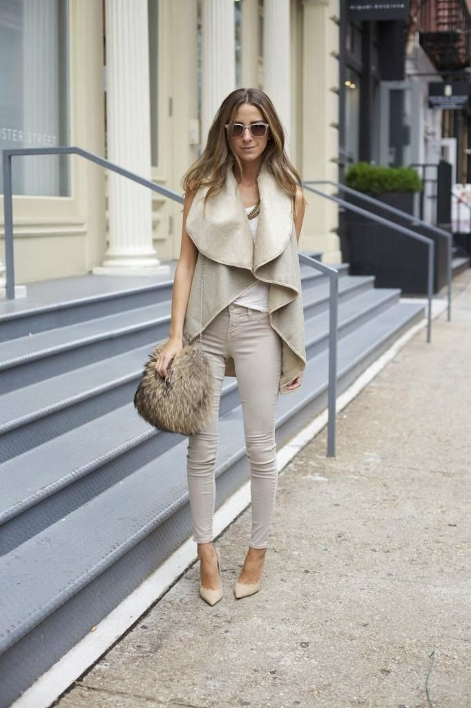 beige coat, periwinkle pants and stylish handbag