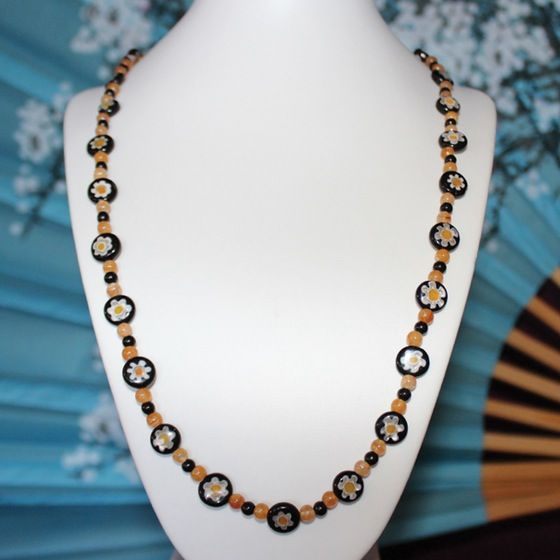 Hello black and yellow! Sometimes all it takes is one simple strand to complete an outfit.