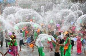 April    18- Songkran Water Festival, Thailand: April 13-15    The Thai New Year festival falls on some of the hottest days in Thailand, and people celebrate by throwing water on each other, using water guns, buckets, hoses- whatever they can get their hands on.