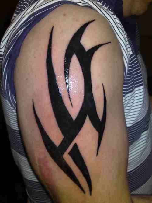Simple Tribal Shoulder Tattoos Sleek simple  and shiny! tribal ...