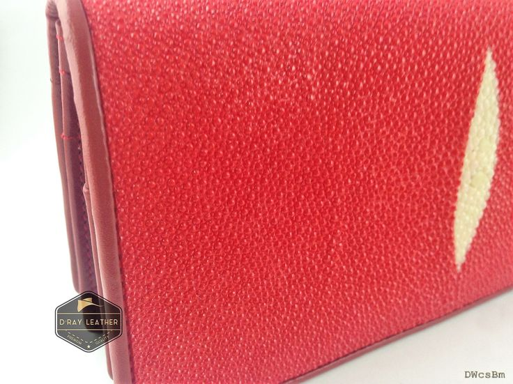 A stingray wallet for woman by @drayleather   Red Color . These stingray wallets have a pebbly texture with a highlighted central diamond.  . A beautifully handmade example of a sting ray wallet with a full cow skin interior. . • Hand selected stingray skin direct from the tannery. • Hand cut leather • A grade cowskin interior • 19cm x 10cm • card holders • ID holders • compartments • Bill divider • Fine stitched edge . Delivery Worldwide   Free Shipping 100% Brand New..