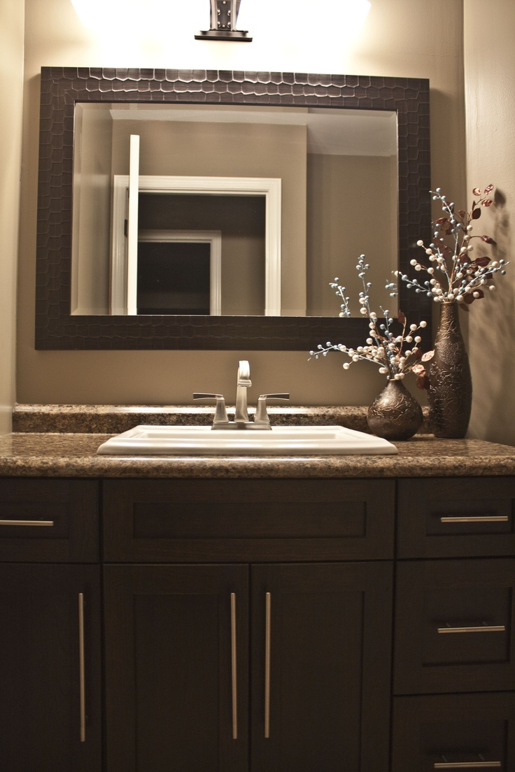 Espresso brown shaker style bathroom vanity with a leather
