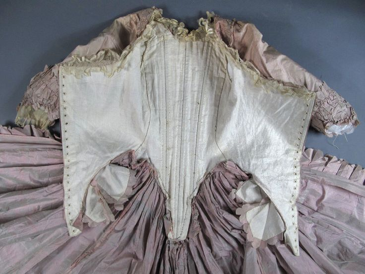 Inside view, robe à l'anglaise and petticoat, France, ca. 1770-1780. Changeable silk taffeta of pale pink and sage green, scalloped and pleated basque flounces, linen lining. Hooped celadon green silk satin quilted petticoat.