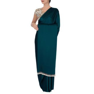 Teal green sari with beige blouse
