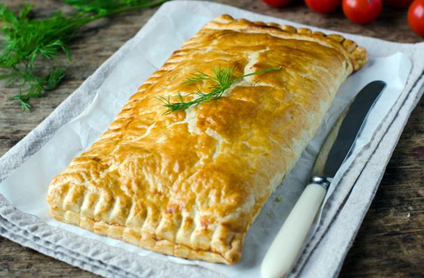 This is a recipe for salmon baked in pastry. The salmon fillets are wrapped in delicious puff pastry and baked until golden brown.