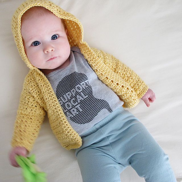 Cute crocheted baby hooded cardigan.