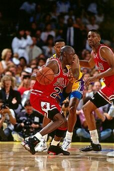 The GOAT sheds Byron Scott with a Bill Cartwright screen during the 91 Finals in L.A.