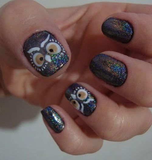 DIY owl nail art on black nails with multi color glitter