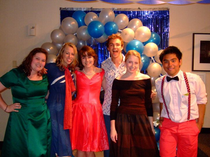 Youth Group Fun Night:  Thrift Store Formal. Girls usually went thrifting together beforehand.  Parents brought finger foods and punch.  The balloon arch was made out of PVC pipe, costing about 10 bucks and giving us a great entrance and photo op.  We used mostly line dances like Cupid Shuffle and Cha Cha Slide, and we crowned a Thrift Store King and Queen.  My most favorite youth group fun night ever.