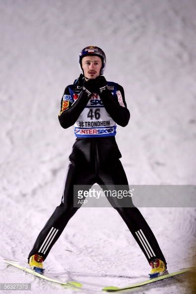 Picture taken 03 December 2005 shows Poland's Adam Malysz competing in the WC Ski Jumping event in Lillehammer central Norway Switzerland's Andreas...
