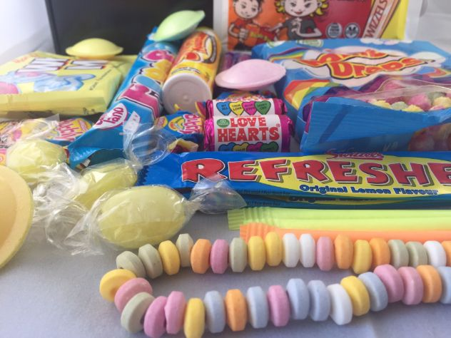 Retro Sweet Hamper including Refresher Bars, Flying Saucers, White Mice, Flumps, Black Jacks, Fruit Salads, Sherbert Lemons, Love Hearts, Rainbow Drops, Candy Necklace and Parma Violets. Perfect for christmas gifts, sweet hampers, sweets for him. retro sweets, classic sweets.