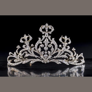 Tiara designed as a tapered openwork panel of old European-cut diamond scrolls; central diamond weighing approximately: 1.40 carats; remaining diamonds weighing approximately: 35.00 carats total;, mounted in platinum topped eighteen karat gold; width: 6 1/4in.  Sold at auction for 35,000 USD.