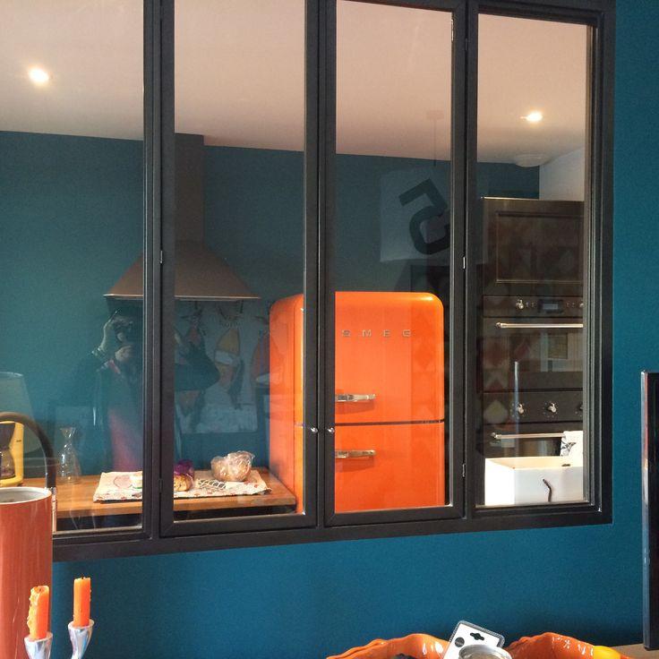 duck green walls and orange smeg fridge