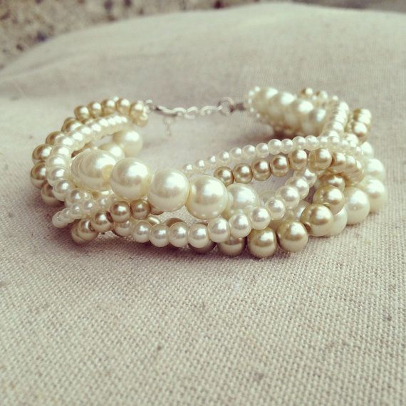 ***Please see shop announcements for current processing time.... Wedding season is upon us... If you are purchasing multiple items for a bridal party order or otherwise please convo me to set up a custom listing...Thank you...***   This stunning braided pearl cuff is photographed here in ivory and light gold pearl (also available in white and gray and silver). This bracelet is elegant and would be perfect for a bridal party, but would also look great with a nice dress. Five strands of pearls…