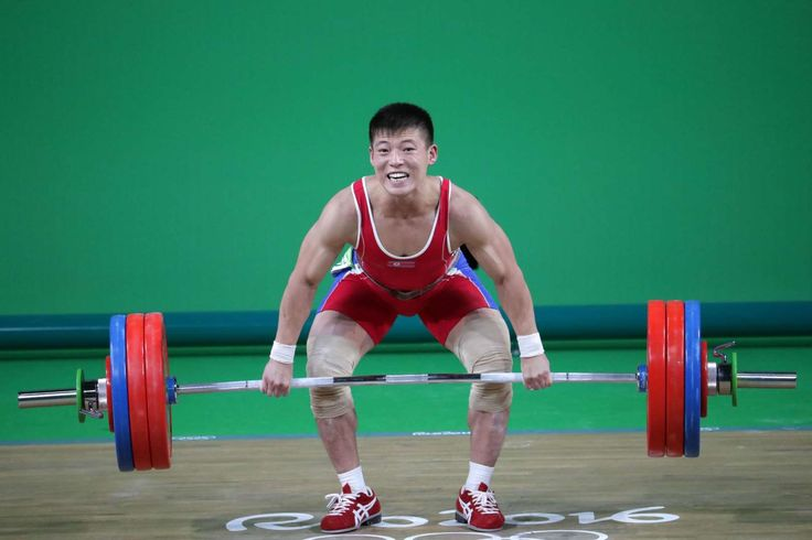 Yong Gwang Kwon of North Korea competes in the men's 69kg weightlifting event at Riocentro - Pavilion 2 during the Rio 2016 Summer Olympic Games.