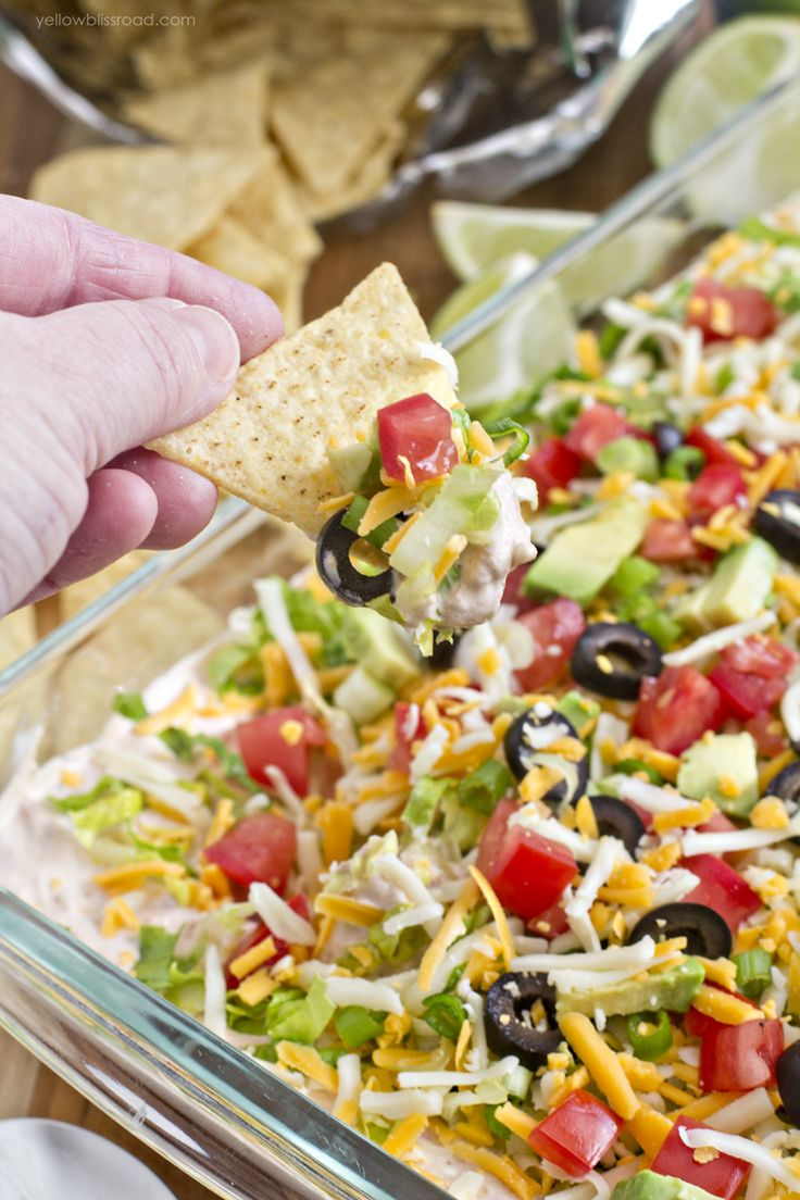 "This lightened up version of the classic 7 Layer Dip is the perfect appetizer for game day parties. Made ""skinny"" with light cream cheese and fat-free greek yogurt, this dip will disappear quickly! About 15 years ago, I was living in my own apartment and was hosting my very first Tupperware party. I had recently …"