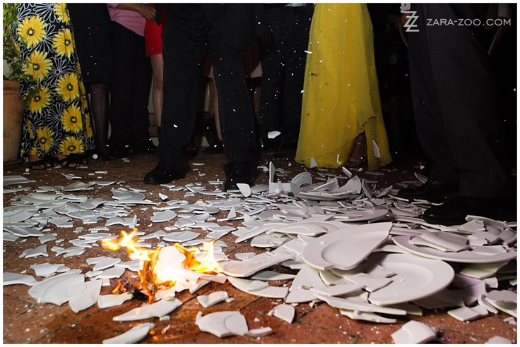 Plates being broken at a Greek wedding at Asara Wine Estate in Stellenbosch, South Africa - Greek Wedding Tradition