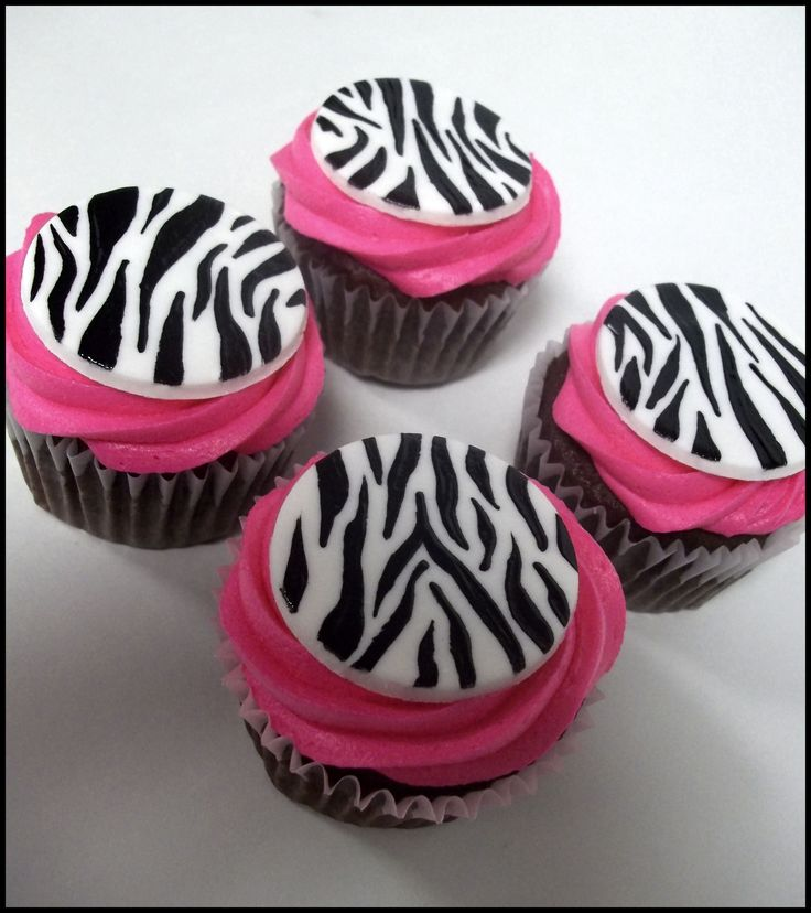 Zebra and pink cupcakes for a birthday - Awesome! Dried vanilla fondant circles painted with gel color in the zebra pattern.