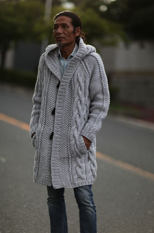 Hand knitted wool cable sweater coat worn by exhausted Japanese man.