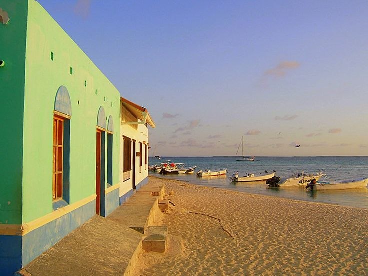 """The houses in this picture are the so called """"posadas,"""" in the Venezuelan archipelago Los Roques.  A """"posada"""" is a former fisherman's house that has been recovered as a guest house. Its most typical characteristic is its colorful front.  Photo by Victor Guntin."""