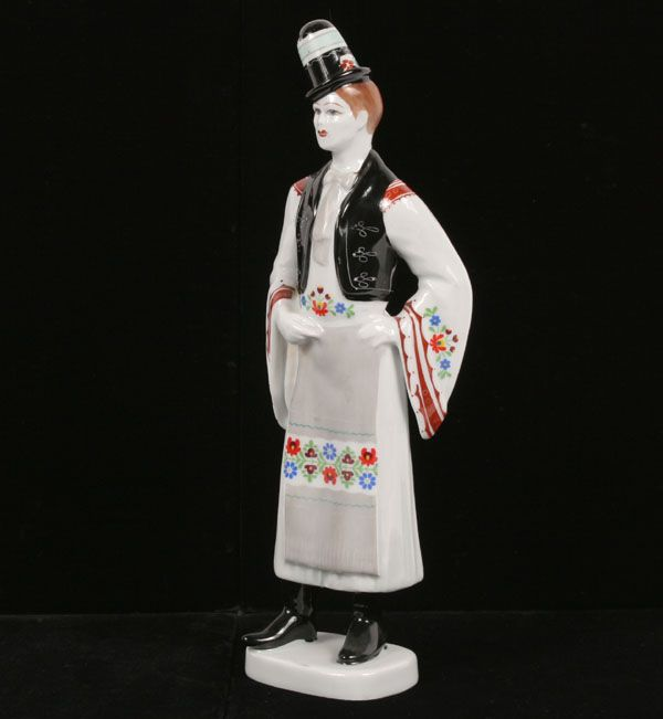 "Hollohaza Hungarian porcelain costumed figure with hand painted detail. 12""H."