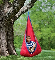 Curl up in the coziest place! Our Indoor/Outdoor HugglePod™ Canvas Hanging Chair is as warm as a hug and soft as a snuggle!