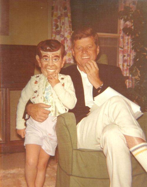 JFK and Caroline wearing a JFK mask, 1962