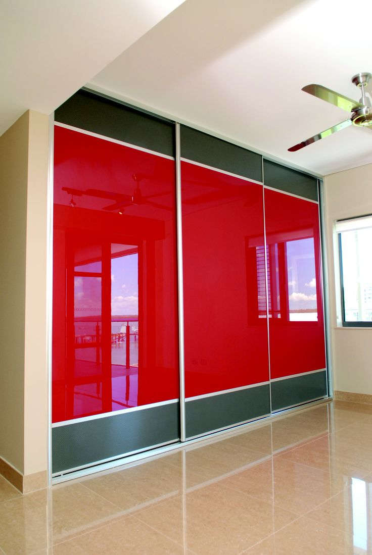 Sliding Wardrobe Doors from our Troppo Range.  Red Stylite with Charcoal mesh.  www.formfunctionnt.com.au