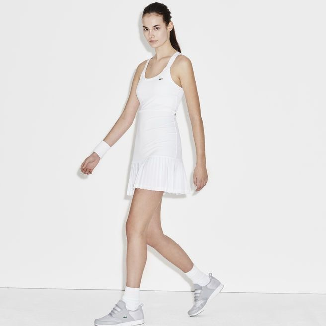 With pretty pleats on the skirt, this colorblock Lacoste SPORT racerback tennis dress in technical jersey is perfect for a spring match.