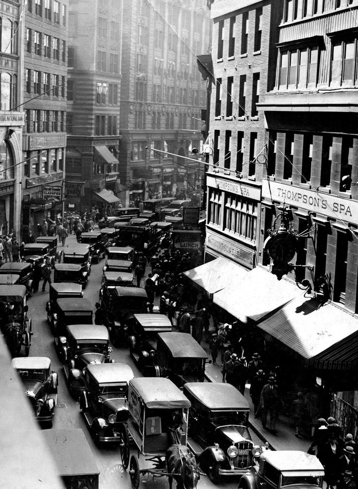 Sept. 23, 1929: In a familiar Boston traffic-jam scene, both horse-drawn carts and automobiles made their way down Newspaper Row around lunchtime.