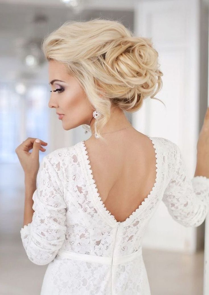 Classic bridal hairdo: French-twist chignon // 10 Timeless Bridal Hair and Makeup Styles from Beauty Expert Candy Tiong